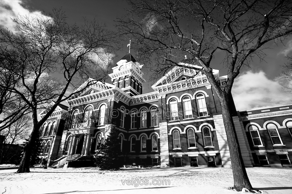 Crown Point Indiana Courthouse in black and white photo. The Lake County Courthouse was built in 1878 and is nicknamed The Grand Old Lady. The courthouse architecture is Romanesque and Georgian. Today it's used for events and has a ballroom and restaurants.