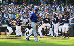September 23, 2017 - Milwaukee, WI, USA - Chicago Cubs relief pitcher Wade Davis walks off the field as the Milwaukee Brewers celebrate their walk off home run in the 10th inning on Saturday, Sept. 23, 2017 at Miller Park in Milwaukee, Wis. (Credit Image: © Chris Sweda/TNS via ZUMA Wire)