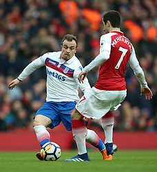 Stoke City's Xherdan Shaqiri (left) and Arsenal's Henrikh Mkhitaryan battle for the ball