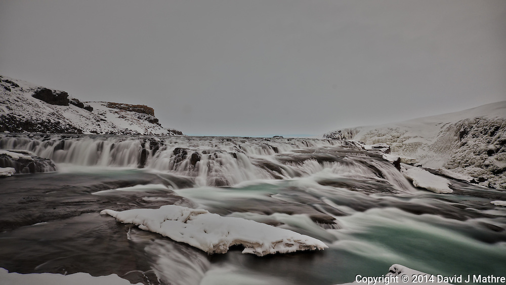 Gullfoss (Golden Waterfall)  on a Late Winter Afternoon. One of most popular tourist attractions in Iceland. Long Exposure taken with a Fuji X-T1 camera and Zeiss 12 mm f/2.8 lens (ISO 200, 12 mm, f/16, 9 sec) with a hand-held 10 stop Singh-Ray neutral density filter.