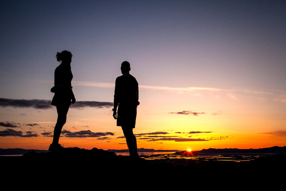 Mindy Campbell and Andrew Jensen watch the sunset from the foothills above Salt Lake City.
