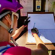Heather Goodrich signs the trail registry for the Lost Lake Trail in Seward, Alaska.