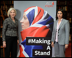 ©Licensed to i-Images Picture Agency. 24/09/2014. London, United Kingdom. The Home Secretary<br /> Theresa may and Sara Khan launch the #makingastand-British Muslim Women New Campaign Against ISIS at Rusia, London. Picture by Andrew Parsons / i-Images