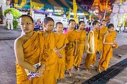 01 OCTOBER 2014 - BANGKOK, THAILAND:  Buddhist novice monks at Wat Yannawa (also spelled Yan Nawa) during the Vegetarian Festival in Bangkok. The Vegetarian Festival is celebrated throughout Thailand. It is the Thai version of the The Nine Emperor Gods Festival, a nine-day Taoist celebration beginning on the eve of 9th lunar month of the Chinese calendar. During a period of nine days, those who are participating in the festival dress all in white and abstain from eating meat, poultry, seafood, and dairy products. Vendors and proprietors of restaurants indicate that vegetarian food is for sale by putting a yellow flag out with Thai characters for meatless written on it in red.    PHOTO BY JACK KURTZ