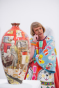 """Artist Grayson Perry RA poses for photographs called """"Bad Portraits of Establishment Figures I ,2012 valued between £50,000- 70,000  at the Royal Academy of Arts in London on October 2nd 2012..."""