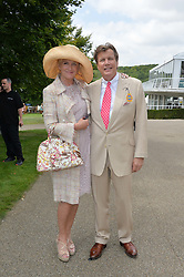 THEO & LOUISE FENNELL at the 2014 Glorious Goodwood Racing Festival at Goodwood racecourse, West Sussex on 31st July 2014.