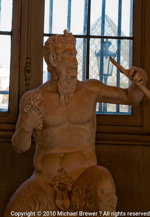 Statue of a seated Bacchus/Pan  at the Louvre, Paris