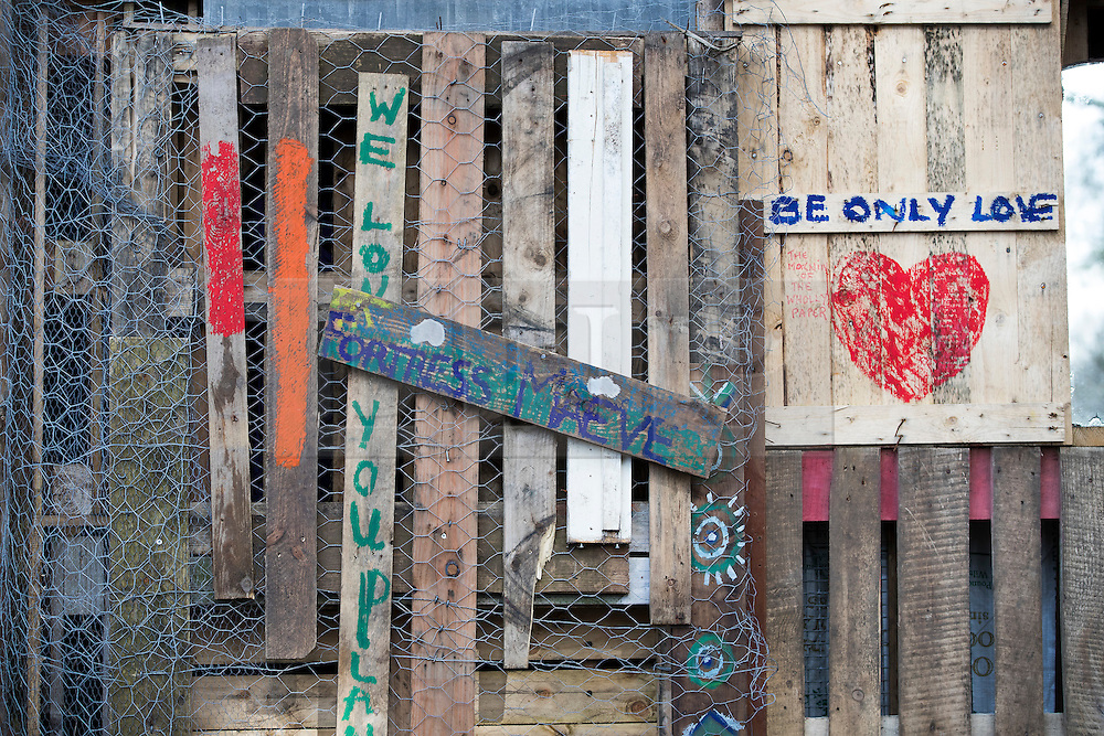 © Licensed to London News Pictures. 02/03/2017. Coldharbour, UK.  Handmade signs adorn the fortress  walls of the 'Protection Camp' on Leith Hill. Activists have constructed and occupied a fort and some trees on the site of a proposed oil well. Planning permission for 18 weeks of exploratory drilling was granted to Europa Oil and Gas in August 2015 after a four-year planning battle. The camp was set up by protestors in October 2016 in order to draw  attention to plans to drill in this Area of Outstanding Natural Beauty (AONB) in the Surrey Hills. The camp has received support from the local community.  Photo credit: Peter Macdiarmid/LNP