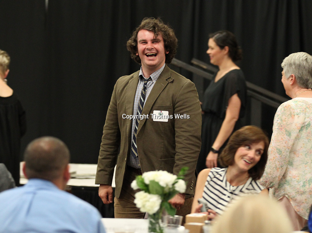 A.J. Stewart picks up his door prize with a big laugh after being chased down from behind to be presented the prize at Thursday's Reader's Choice Awards.