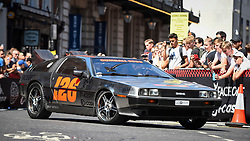 © Licensed to London News Pictures. 05/08/2018. LONDON, UK. A DeLorean sets off from the start.  Gumball 3000, a charity rally for supercars and more, including celebrity entrants, begins in Covent Garden with 150 participants beginning their journey from London to Tokyo.  Photo credit: Stephen Chung/LNP