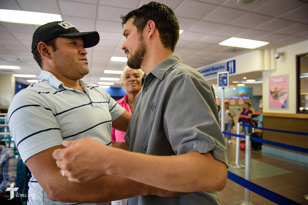 The Rev. Stephen Heimer, pastor of Zion Lutheran Church, El Paso, Texas, and chief operating officer of YLM,  hugs goodbye to Antonio Cutino, a Cuban immigrant, as he prepares to board the Greyhound bus on Saturday, May 21, 2016, near Ysleta Lutheran Mission Human Care in El Paso, Texas. LCMS Communications/Erik M. Lunsford