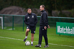 CARDIFF, WALES - Sunday, October 13, 2013: Wales' physiotherapist David Weeks and Medical Officer Doctor Jon Houghtonn during a training session at the Vale of Glamorgan ahead of the 2014 FIFA World Cup Brazil Qualifying Group A match against Belgium. (Pic by David Rawcliffe/Propaganda)