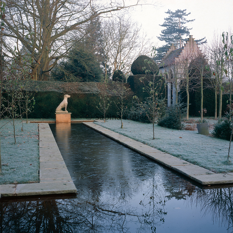 View across the Canal with Statue and Sulking House, Dutch Garden, Bryan's Ground, Herefordshire. Design : David Wheeler & Simon Dorrell