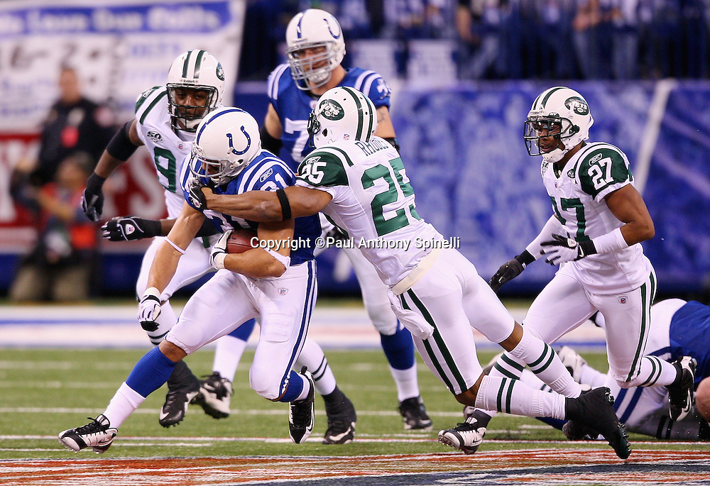 Indianapolis Colts running back Donald Brown (31) runs for a first quarter first down as he gets tackled by New York Jets safety Kerry Rhodes (25) during the AFC Championship football game against the New York Jets, January 24, 2010 in Indianapolis, Indiana. The Colts won the game 30-17. ©Paul Anthony Spinelli