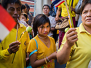 05 DECEMBER 2014 - BANGKOK, THAILAND: Thais file into the Grand Palace Friday morning to pray for and hoping to see Bhumibol Adulyadej, the King of Thailand. Thais marked the 87th birthday of the King Friday. The revered Monarch was scheduled to make a rare public appearance in the Grand Palace but cancelled at the last minute on the instructions of his doctors. He has been hospitalized in Siriraj Hospital, across the Chao Phraya River from the Palace, since early October.    PHOTO BY JACK KURTZ