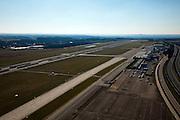 Nederland, Limburg, Beek, 07-03-2010; Maastricht Aachen Airport (Luchthaven Zuid-Limburg Airport), overzicht van de startbaan / landingsbaan, rechts autosnelweg A2; overview of the runway and A2 motorway (r).luchtfoto (toeslag), aerial photo (additional fee required);.foto/photo Siebe Swart