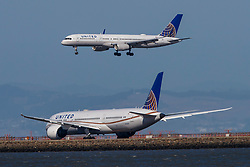 Boeing 757-224 (N17139) operated by United Airlines landing past Boeing 787-9 Dreamliner (N27957) operated by United Airlines at San Francisco International Airport (KSFO), San Francisco, California, United States of America