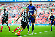 Grimsby Town defender Richard Tait holds off FC Halifax Town striker Richard Peniket during the FA Trophy match between Grimsby Town FC and Halifax Town at Wembley Stadium, London, England on 22 May 2016. Photo by Mike Sheridan.