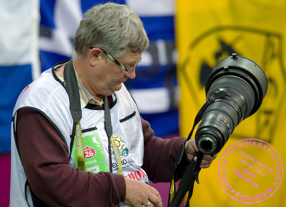Photographer Marek Biczyk with Nikon's lens during the UEFA EURO 2012 Quarterfinal football match between Germany and Greece at Gdansk Arena in Gdansk on June 22, 2012...Poland, Gdansk, June 22, 2012..Picture also available in RAW (NEF) or TIFF format on special request...For editorial use only. Any commercial or promotional use requires permission...Photo by © Adam Nurkiewicz / Mediasport