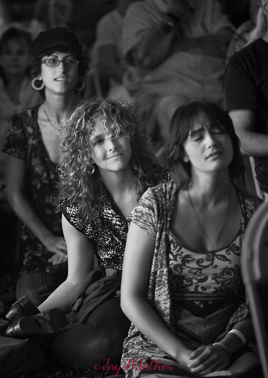 Left to right:  Shireen Amini, Abagail Washburn, Phoebe Hunt watch the Community Celebration performances at the Village Green venue, Sisters Folk Festival 2012