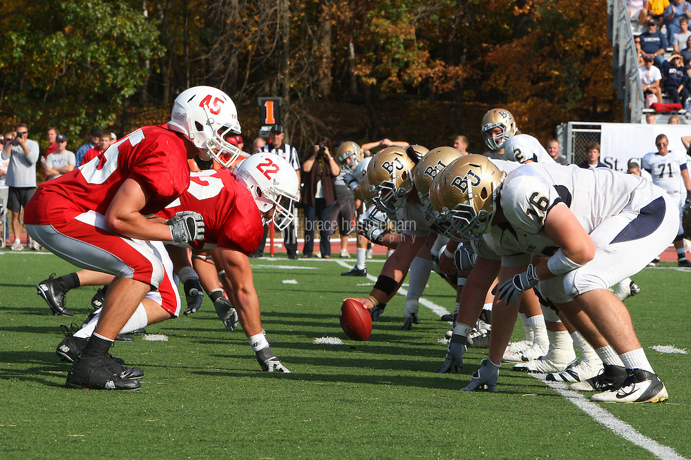 SJU defense lines up against Bethel. Credit: Brace Hemmelgarn-Saint John's University