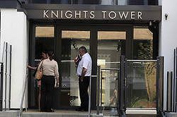 © Licensed to London News Pictures. 11/06/2014. Knights Tower. Police officers enter the building. Two teenagers have died after falling from a sixth-floor balcony during a party in Deptford. Police were called this morning (June 11) at 12.13am to Knights Tower in Wharf Street to reports of two people having fallen from a balcony. An 18-year-old man and a 19-year-old woman were pronounced dead at the scene. Local people have identified the flat as having a Turkish flag in the window next to the balcony. Byline:Grant Falvey/LNP