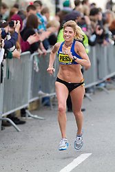 2013 Boston Marathon: masters woman Sheri Piers smiles with a mile to go