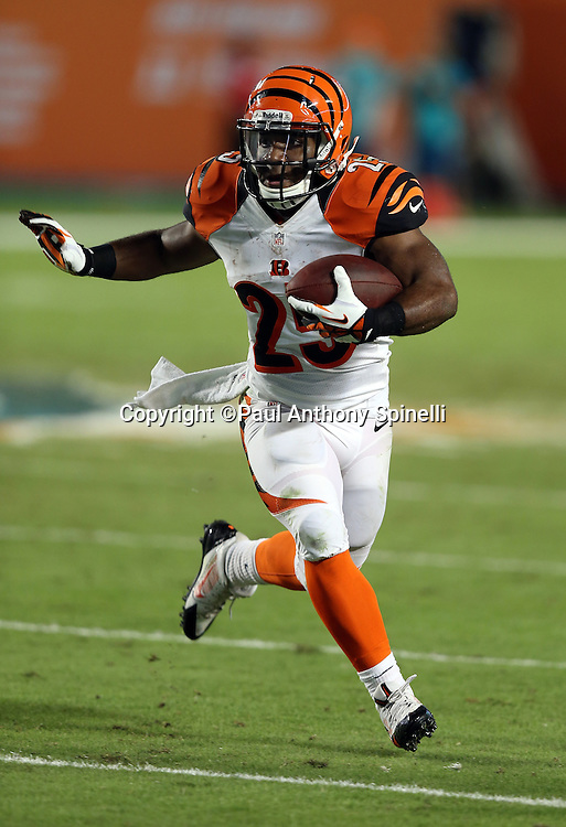 Cincinnati Bengals running back Gio Bernard (25) runs with the ball after catching a flat pass for a third quarter gain of six yards during the NFL week 9 football game against the Miami Dolphins on Thursday, Oct. 31, 2013 in Miami Gardens, Fla.. The Dolphins won the game 22-20 in overtime. ©Paul Anthony Spinelli