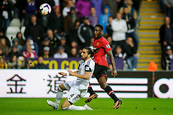 Man Utd Forward Danny Welbeck (ENG) chips the ball over Swansea Defender Chico Flores (ESP) to score his sides 4th goal during the second half of the match - Photo mandatory by-line: Rogan Thomson/JMP - Tel: Mobile: 07966 386802 17/08/2013 - SPORT - FOOTBALL - Liberty Stadium, Swansea -  Swansea City V Manchester United - Barclays Premier League - First round of the 2013/14 season and the first league match for new Man Utd manager David Moyes.