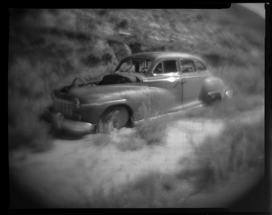 Old 1950's car left to rust in the country.