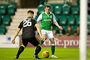 Hibernian midfielder John McGinn (#7) takes on Livingston defender Raffaaele De Vita (#26) during the Betfred Scottish Cup match between Hibernian and Livingston at Easter Road, Edinburgh, Scotland on 19 September 2017. Photo by Craig Doyle.