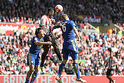 Sunderland defender Lamine Kone (23)  heads clear from Leicester City defender Robert Huth (6)  during the Barclays Premier League match between Sunderland and Leicester City at the Stadium Of Light, Sunderland, England on 10 April 2016. Photo by Simon Davies.