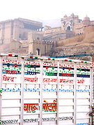 The Amber Palace rises behind a gaily painted truck, Rajasthan.