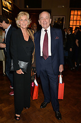 PHILIP & DIANA HARARI at a party to celebrate the launch of the Maison Assouline Flagship Store at 196a Piccadilly, London on 28th October 2014.  During the evening Valentino signed copies of his new book - At The Emperor's Table.