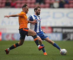 Dan Gardner of Oldham Athletic (L) and Nick Powell of Wigan Athletic in action - Mandatory by-line: Jack Phillips/JMP - 30/03/2018 - FOOTBALL - DW Stadium - Wigan, England - Wigan Athletic v Oldham Athletic - Football League One