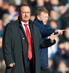 LIVERPOOL, ENGLAND - Saturday, February 6, 2010: Liverpool's manager Rafael Benitez and Everton's manager David Moyes during the Premiership match at Anfield. The 213th Merseyside Derby. (Photo by: David Rawcliffe/Propaganda)