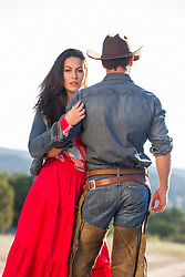 rear view of a cowboy in chaps with a girl