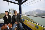 Lantau island. Ngong Ping Skyrail. Tourist couple from Korea.