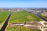 Nederland, Friesland, Leeuwarden, 01-05-2013; aanleg N31 de Haak om Leeuwarden. Bouw aquaduct Van Harinxmakanaal, Leeuwarden in de achtergrond..De nieuwe rijksweg vormt de verbinding tussen de huidige A31 bij Marsum en de N31 bij Hemriksein (Wâldwei)..Construction of new motorway  N31 near Leeuwarden (back), crossing channel Harinxmakanaal, construction of an aqueduct..luchtfoto (toeslag op standard tarieven).aerial photo (additional fee required).copyright foto/photo Siebe Swart