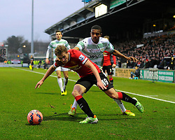 Manchester United's James Wilson gets the better of Yeovil Town's Stephen Arthurworrey  - Photo mandatory by-line: Joe meredith/JMP - Mobile: 07966 386802 - 04/01/2015 - SPORT - football - Yeovil - Huish Park - Yeovil Town v Manchester United - FA Cup - Third Round