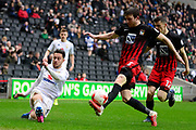 Milton Keynes Dons defender George Baldock (2) crosses under pressure  from Coventry City defender Chris Stokes (3) during the EFL Sky Bet League 1 match between Milton Keynes Dons and Coventry City at stadium:mk, Milton Keynes, England on 18 March 2017. Photo by Dennis Goodwin.
