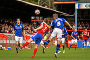 Oliver Lancashire beats Glenn Wilson to the ball during the The FA Cup match between Aldershot Town and Rochdale at the EBB Stadium, Aldershot, England on 7 December 2014.
