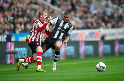 NEWCASTLE, ENGLAND - Sunday, March 4, 2012: Newcastle United's Danny Simpson in action against Sunderland's James McLean during the Premiership match at St. James' Park. (Pic by David Rawcliffe/Propaganda)