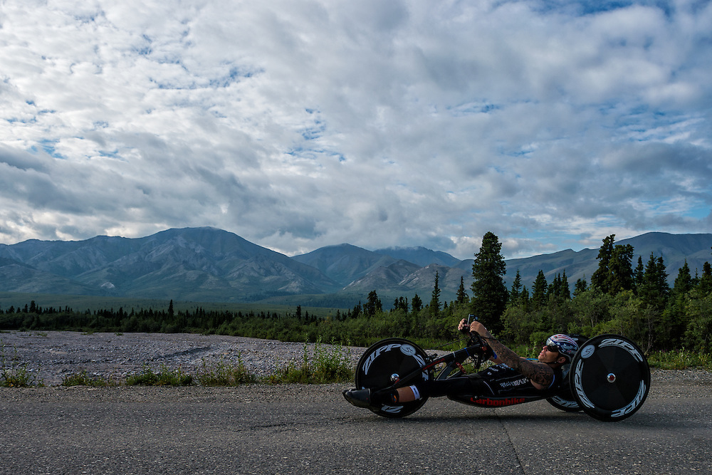 July 25, 2015: Anthony Pedeferri races along Denali Park Road during stage five of the 2015 Alaska Challenge handcycle race.