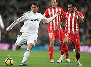 Real Madrid's Cristiano Ronaldo against Almeria's JM Ortiz during La Liga match, November 05, 2009.