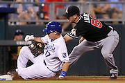 Kansas City Royals' Chris Getz (17) is tagged out at third by Miami Marlins third baseman Ed Lucas (59) after attempting to advance from second off a fly ball in the eighth inning of a baseball game at Kauffman Stadium in Kansas City, Mo., Monday, Aug. 12, 2013. (AP Photo/Colin E. Braley)