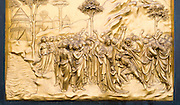 Religious scene in gold on bronze on the Baptistry doors of Il Duomo di Firenze, Cathedral of Florence, in Piazza di San Giovanni, Italy