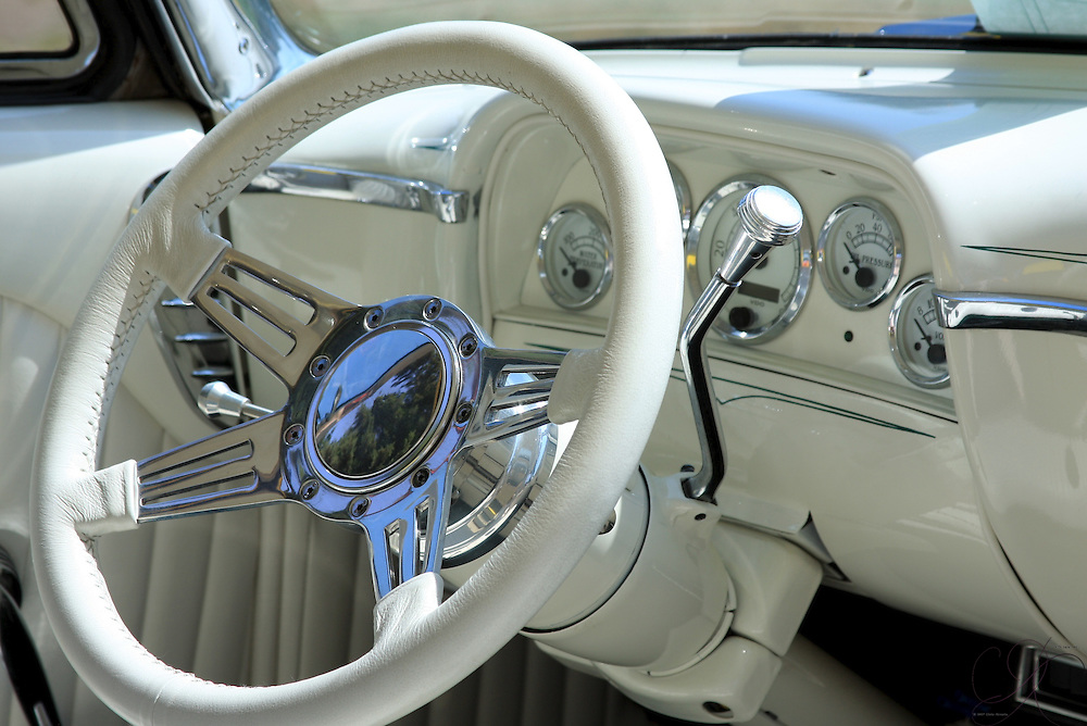 White and Chrome interior combine into a brilliant cabin in this 1954 Mercury