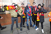 Fans of Liverpool forward Takumi Minamino (18) arrive for the Premier League match between Liverpool and Manchester United at Anfield, Liverpool, England on 19 January 2020.