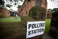 Voters arriving at a polling station in Hoylake, Wirral to cast their votes at the 2015 UK General Election. They were voting in the marginal Wirral West constituency, held since the 2010 election by Esther McVey MP for the Conservative Party. Voters went to the polls across the UK on 7th May to elect 659 member of parliament.